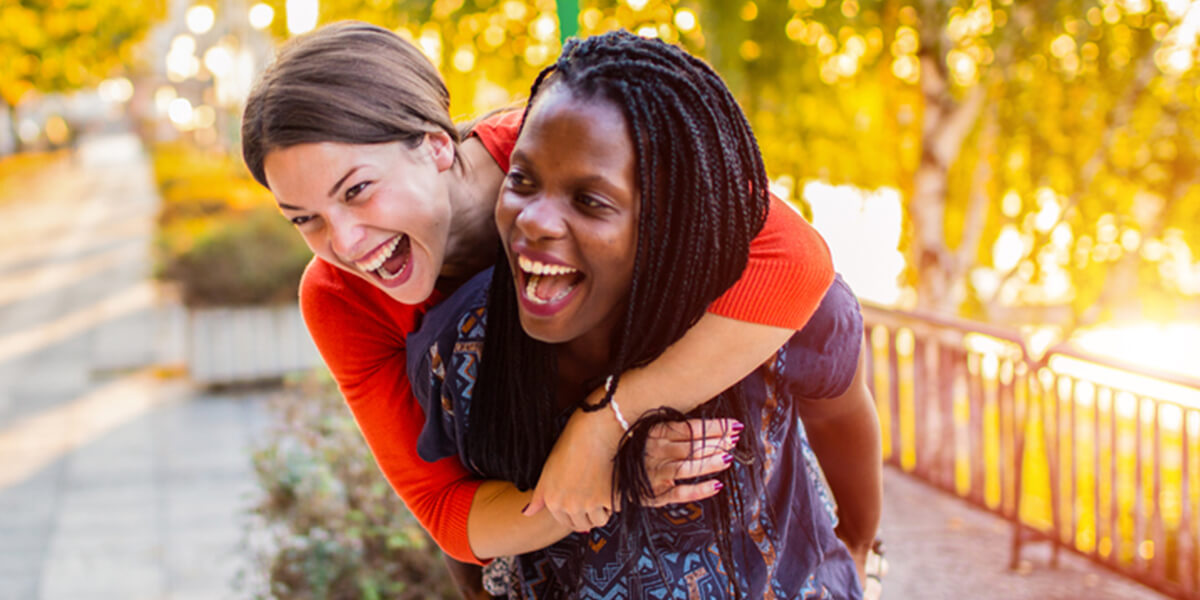 two women hugging smiling - what happens if able account beneficiary is no longer disabled