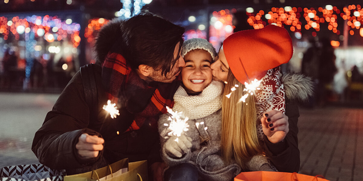family at holidays smiling - neurodiverse financial planning and counseling services