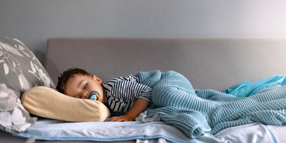 child sleeping in bed  - helping your autistic child get a better nights sleep