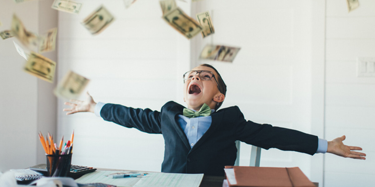 boy catching falling money - 2020 congress reverses recent changes to the kiddie tax