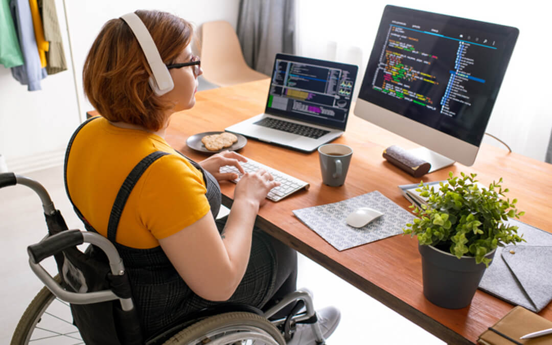 disabled person working at desk - a case for working when you have a disability