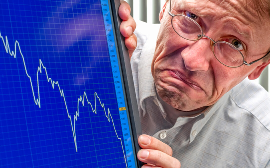 frowning man sinking stock exchange - stock market crash impact on autism and anxiety