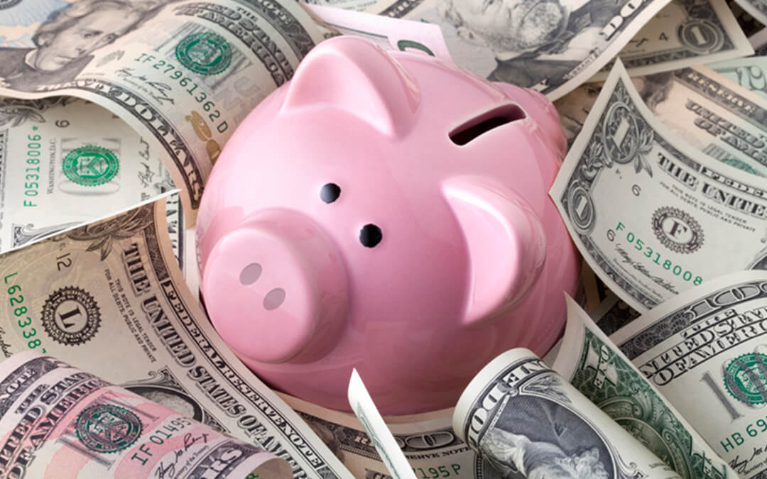 piggy bank on dollar bills - an introduction to able accounts financial planning with special needs