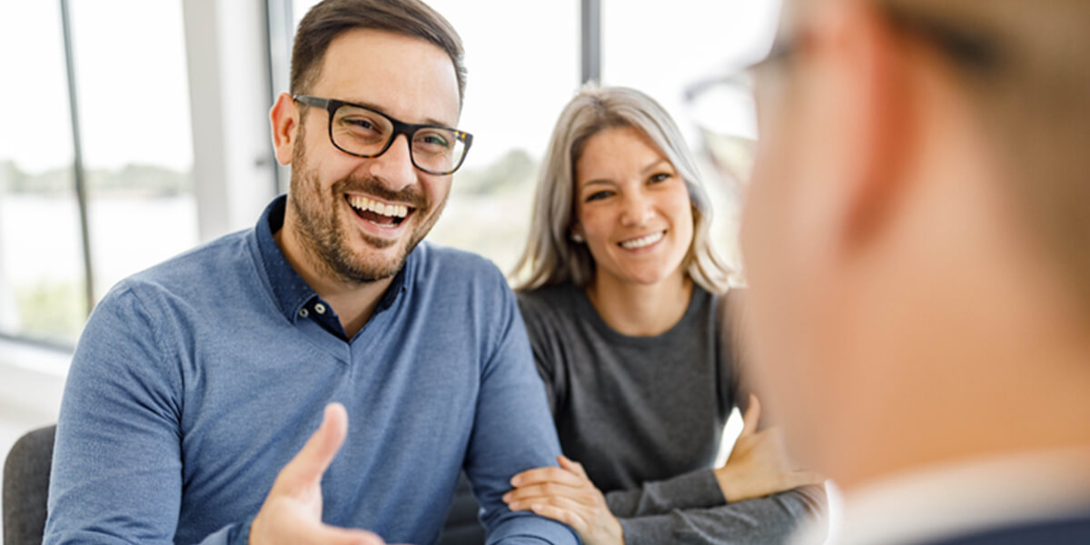 couple meeting with planner - certified neurodiverse financial planning services