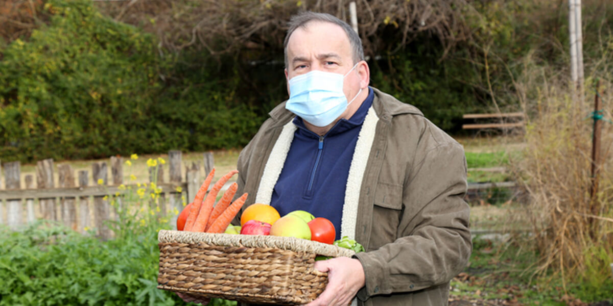 man working outside with mask on - neurodiverse employer benefit planning services