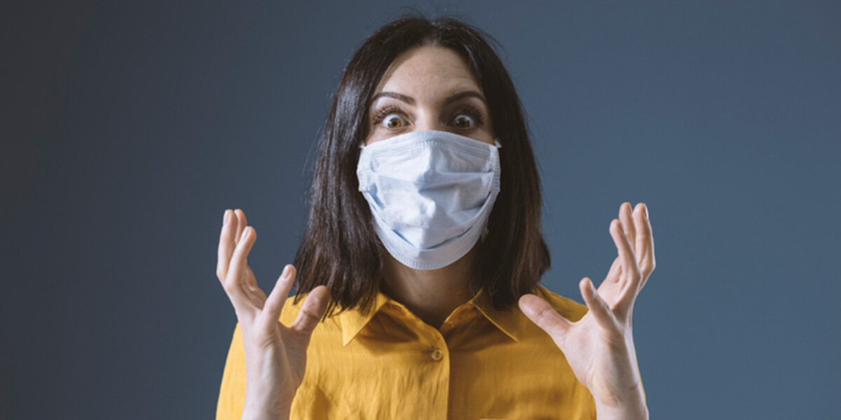 panicked woman in face mask - no time to panic for special needs people with financial planning
