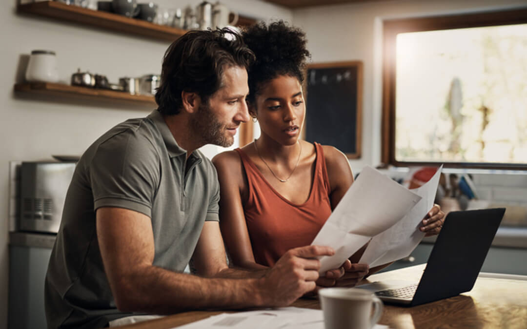 mixed couple reviewing expenses - five practical uses for able account certified financial planning