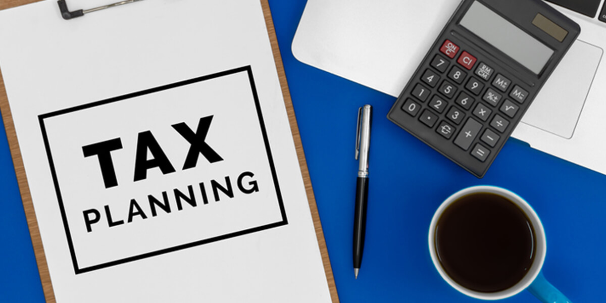 view of calculator, tax planning, coffee cup - special needs tax planning services farmington ct