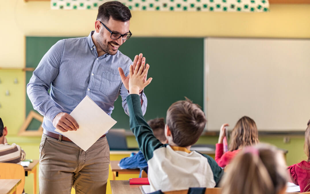 teacher high five student in class - how to stop using special needs functioning labels