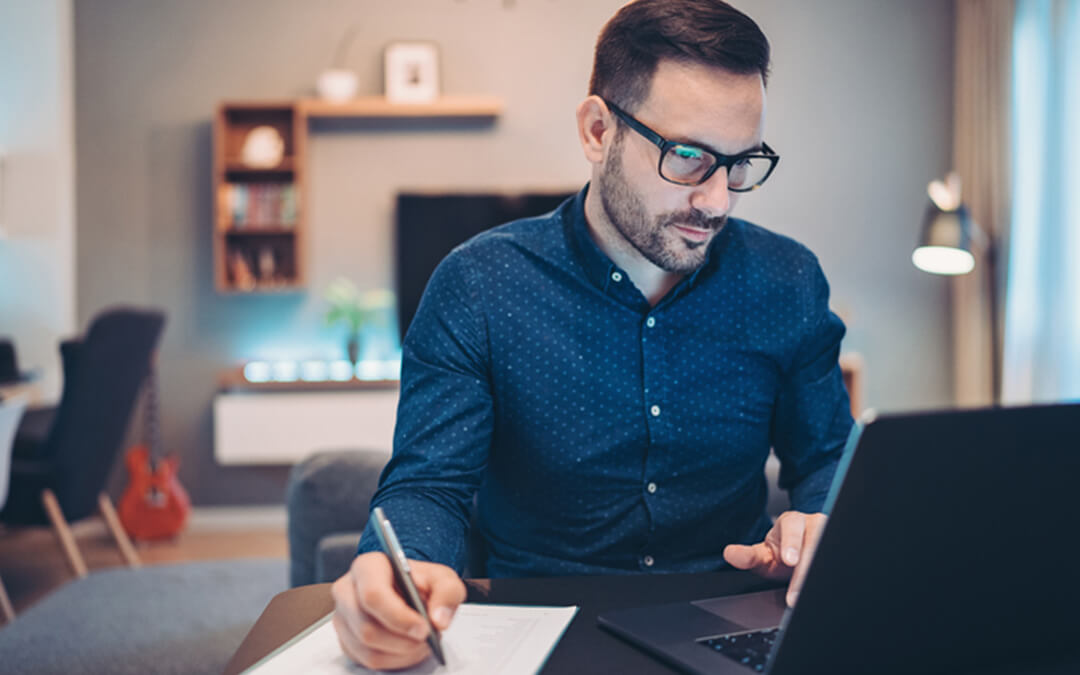 man at desk looking at computer - what is a special needs advisor? - financial planning services