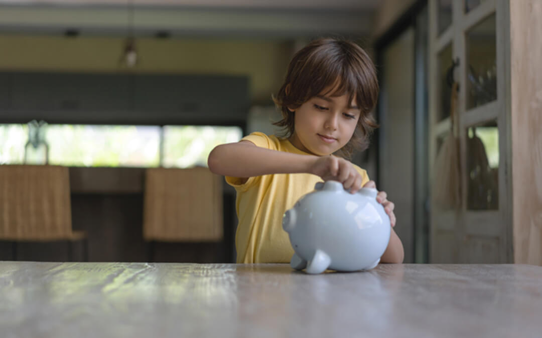 small boy coins in piggy bank - who can open an able able account certified financial planning
